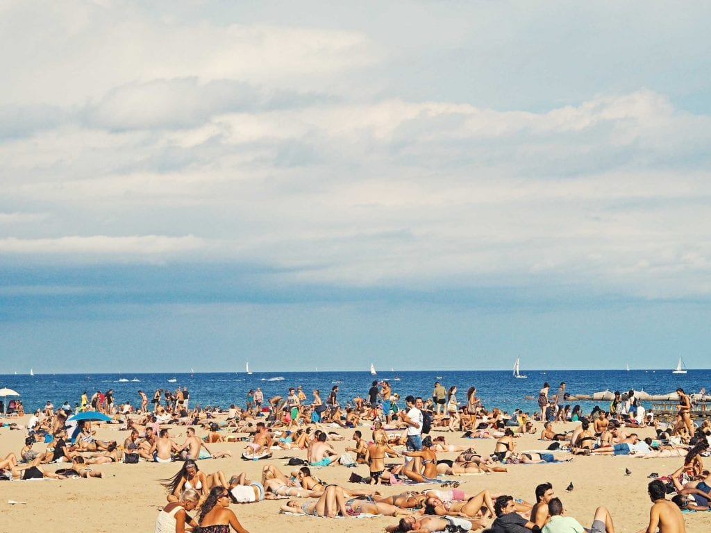 Barceloneta beach full of people and tourists during summer in barcelona