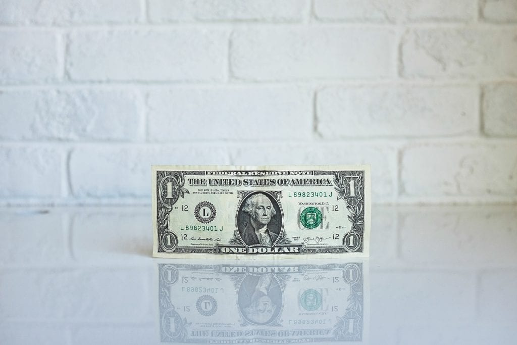 a one dollar bill on a table